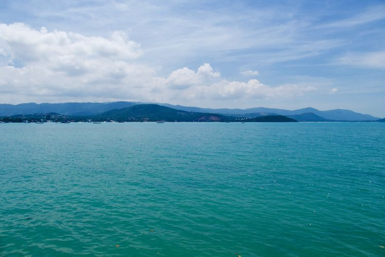 Scenics - Nature Beauty In Nature Water Cloud - Sky Sky Idyllic Sea Tranquility Waterfront Mountain Day Nature Mountain Range Turquoise Colored View Into Land Remote Non-urban Scene No People Shoreline Coastal Feature Koh Samui,Thailand View From Above Sea And Sky