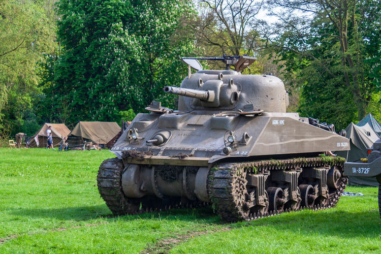 Sherman Armed Forces Armored Tank Army Battle Day Field Government Grass Green Color Land Metal Military Mode Of Transportation Nature No People Outdoors Plant Sherman Tank Tank Transportation Tree Weapon