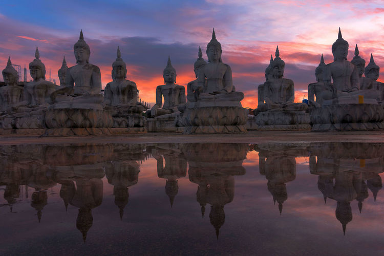 Statue of temple against sky during sunset