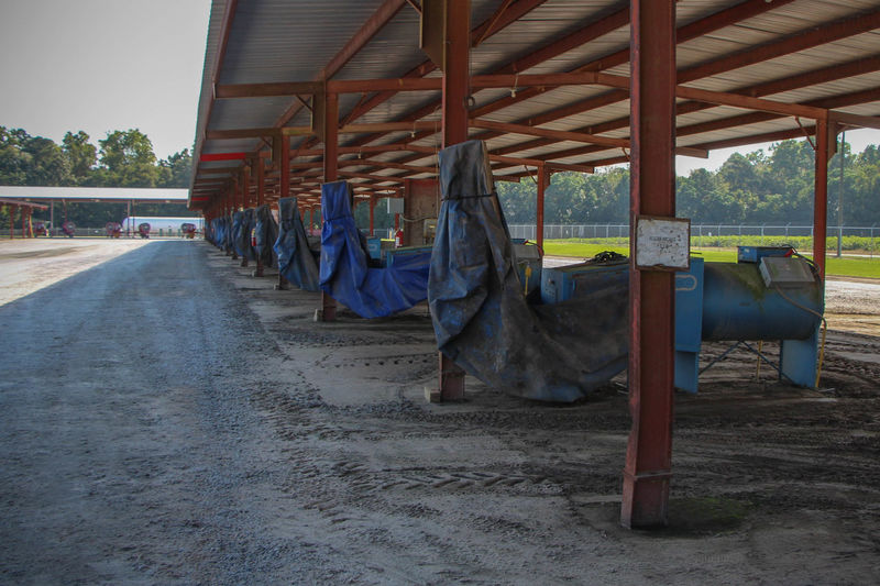 Agricultural machinery under shed at farm