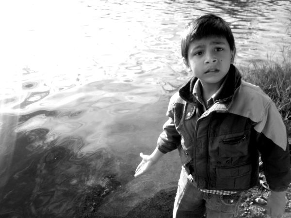 Beauty is in the innocence of a child, and a heart so pure can always be cherished. Their presence makes everything and everyone else around feel beautiful.. Kids Innocenceofachild Portrait Of Innocence Innocence Lake Blackandwhite . Beauty Redefined