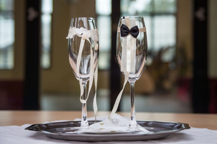 Close-Up Of Champagne Flutes On Plate During Wedding
