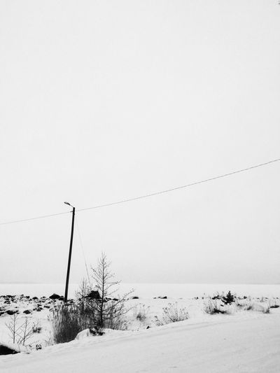 White Frozen Water Snow Winter Cold Temperature Copy Space Cable Weather Clear Sky Nature Outdoors No People Landscape Day Sky Beauty In Nature Scenics