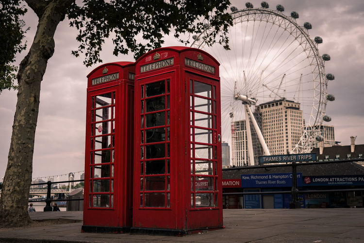 Red Built Structure Ferris Wheel Architecture Building Exterior Telephone City Telephone Booth No People Travel Destinations Arts Culture And Entertainment Sky Communication Connection Outdoors EyeEm Best Shots Eye4photography  London
