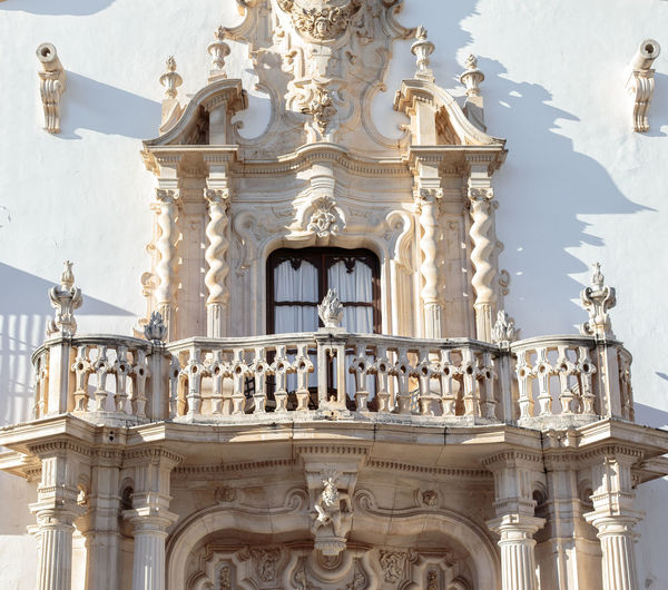 Beautiful baroque balcony of the Marques de la Gomera Palace in Osuna. Ducal town declared a Historic-Artistic Site. Southern Spain. Picturesque travel destination on Spain. Osuna SPAIN Seville Art Tourism Tourism Destination White Villages Village Palace Europe Noble Andalusia Andalusian Architecture Building Baroque Baroque Architecture Andalucía Travel Travel Destinations Blue Blue Sky Architecture Colonial Façade Facade Detail Balcony Tourist Tourist Destination Mediterranean  Traveler Beautiful Sky House Traditional Destination Vacations Landmark Picturesque Culture