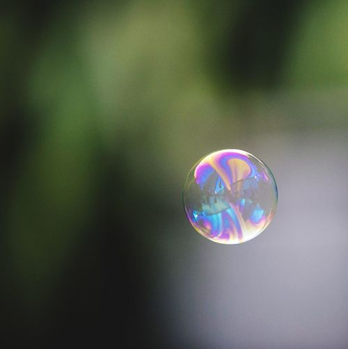 Bubbles Bubble One Bubble Single Bubble Solo Bubble Fragility Mid-air No People Spectrum Focus On Foreground Multi Colored Day Outdoors Close-up Green Green Color Rainbow Colors Rainbow