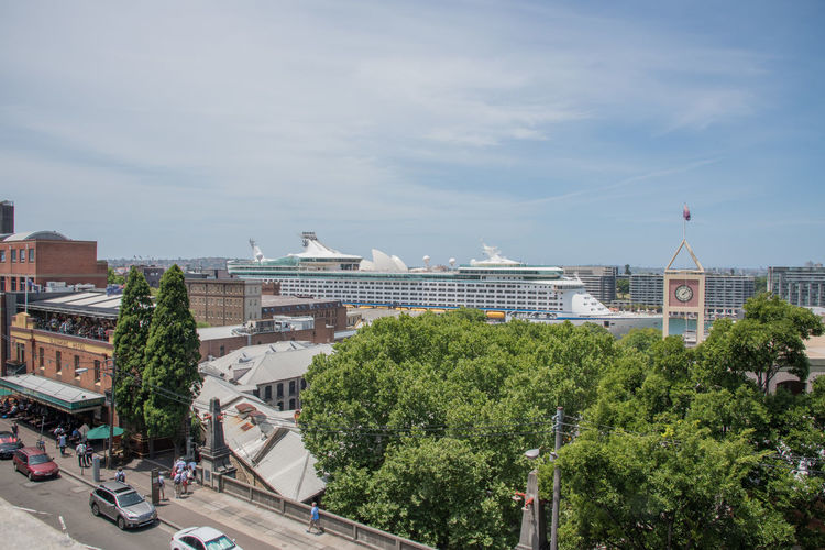 Sydney,NSW,Australia-November 20,2016: Elevated view over the Circular Quay with Royal Caribbean cruise ship, clock tower and people eating out at the Glenmore Hotel in Sydney, Australia Architecture Australia City Cruise Ship Explorer Of The Seas Royal Caribbean Cruise Sydney Harbour  Tourists Transportation Tree Alfresco Dining Building Exterior Circular Quay Clock Clock Tower Cruise Elevated View Glenmore Hotel High Angle View Real People Restaurant Royal Caribbean Ship Sydney Tourism