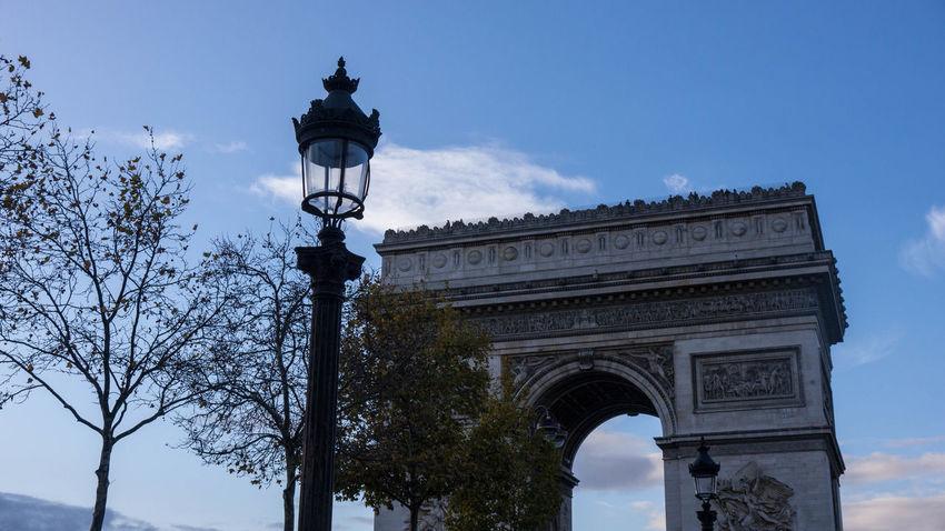 Arc De Triomphe De L'Étoile Arc De Triomphe Arch Architecture Built Structure Cloud - Sky History Low Angle View Monument Outdoors Sky Street Light Travel Destinations Triumphal Arch