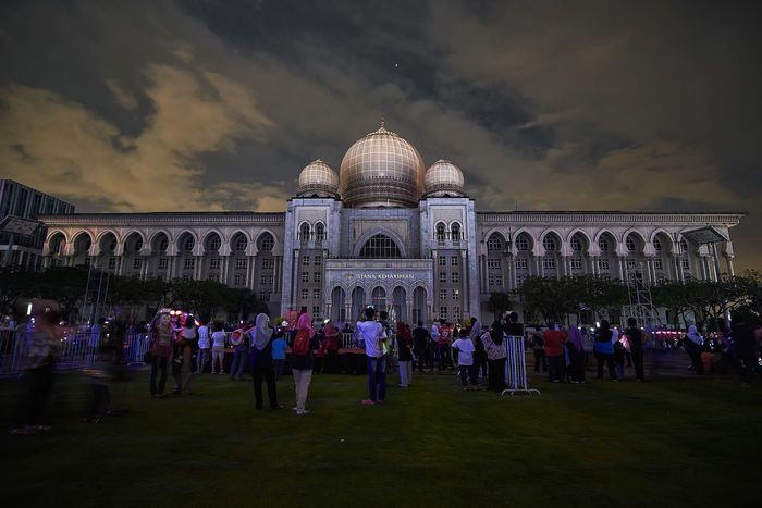 PUTRAJAYA - DECEMBER 31: A colorful projection mapping show with the background view of Palace Of Justice on December 31, 2017 in Putrajaya. Colors Landscape_Collection Architecture Building Exterior Built Structure Cloud - Sky Color Colorful Dome Landscape Landscape_photography Large Group Of People Leisure Activity Lifestyles Mixed Age Range Old Ruin Outdoors Projection Mapping Projection Screen Sky Tourism Travel Travel Destinations Vacations Weekend Activities