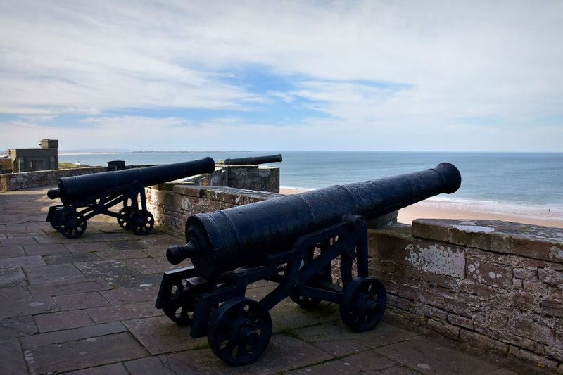 Cannon Sky Water Sea Cloud - Sky History The Past Weapon Fighting War Conflict Nature Architecture Day Military No People Outdoors Horizon Over Water Tranquil Scene Wheel Castle Battlements Wall Coastal Feature Coast Blue Sky Coastline Battle Historic Building Bamburgh Bamburgh Castle Looking Out Lookout View