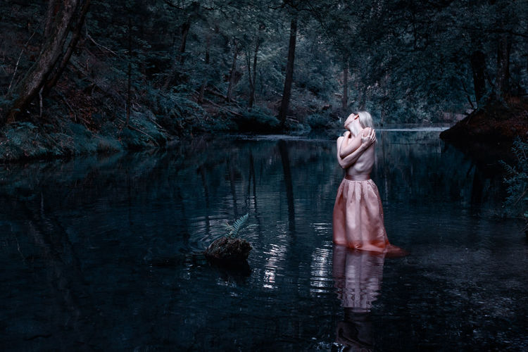 Woman standing in water Colours Fine Art Photography TheWeek On EyEem TheWeekOnEyeEM Colours Morning Art Blue Water Canon Canonphotography Dark Emotion Fine Art Forest Nature One Person Outdoors Reflection Sensual_woman Sensualart Sigma 30mm/1.4 Art Skirt Spooky Standing Water Women