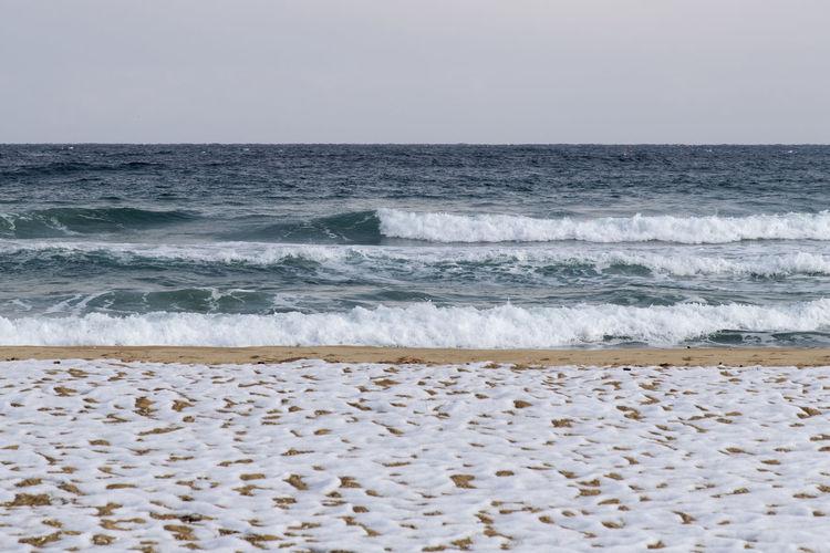 Hwajinpo Beach in Goseong, Gangwondo, South Korea Beach Land Water Beauty In Nature Outdoors Hwajinpo Beach Winter Beach Winter Sea Tranquil Scene Naturelovers Natur's Beauty Sea Motion Horizon Wave Horizon Over Water Sky Aquatic Sport Surfing Scenics - Nature Sand Sport Nature Idyllic Day Pebble