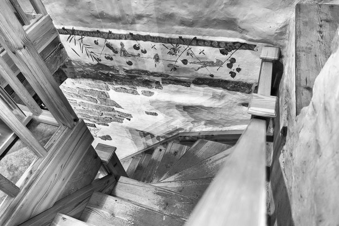 Refuge. Architecture Beaten Beaten Steps Blackandwhite Built Structure Day Downward View Hand Rail Indoors  Masonry No People Nusshain 05 17 Spiral Staircase Steps Steps And Staircases The Architect - 2017 EyeEm Awards Wall Painting Wood - Material Wooden Staircase