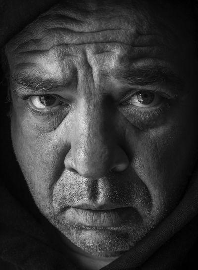 Close-up portrait of a mid adult man