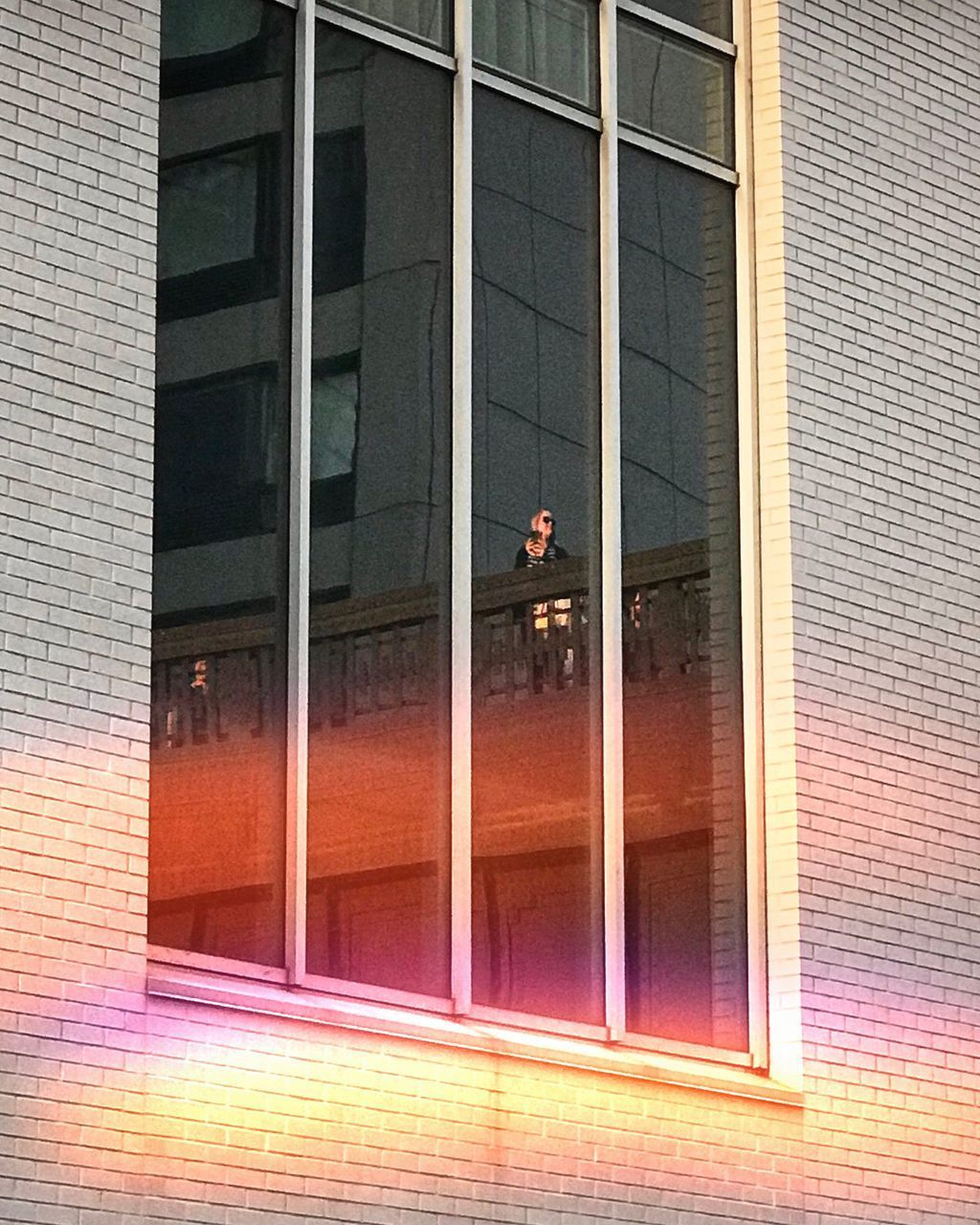architecture, built structure, building exterior, window, building, glass - material, reflection, no people, glass, day, outdoors, brick, wall, city, brick wall, modern, transparent, wall - building feature, low angle view, purple, place, window frame