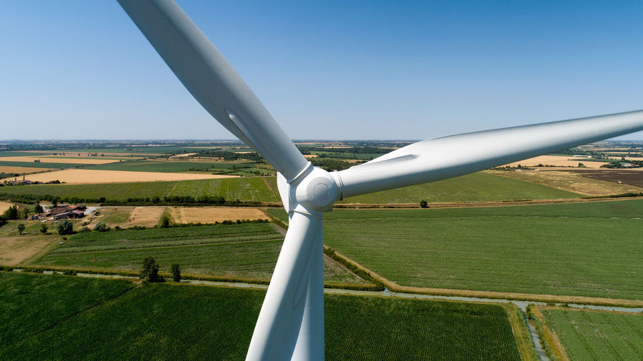 Close up photography of a wind turbine in the french countryside Wind Turbine Windmill Close Up Photography Aerial View Aerial Photography Drone Shot Front Above Landscape Field Agriculture Rural Scene Environment Propeller White Color Renewable Energy Power Wind Sustainable Technology Green Nature Day Sunny Summer Horizon Grass Outdoors Land