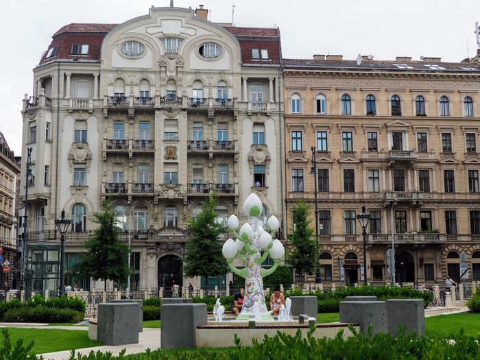 Statue in front of building