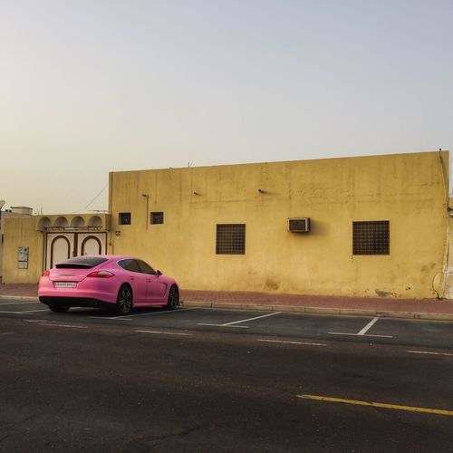 Urban Pink Fever / captured in Dubai with my iPhone6 Urban Spring Fever Car Cars Porsche Enjoying Life Mydubai Dubai EyeEm Best Edits Streetphotography Architecture EyeEm Best Shots Scenics Check This Out Check This Out Hello World Tranquility Taking Photos Hanging Out Cheese! Pink Beauty In Nature Standing Lonely Original Experiences Mein Automoment