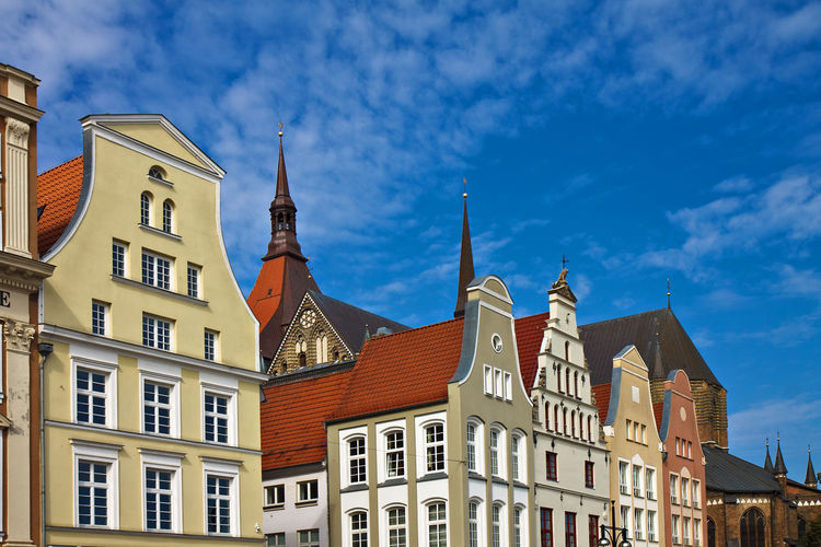 Low angle view of traditional buildings in city against sky