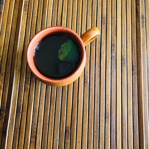 High angle view of tea cup on wooden table