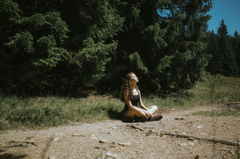 Young Woman Sitting On Field