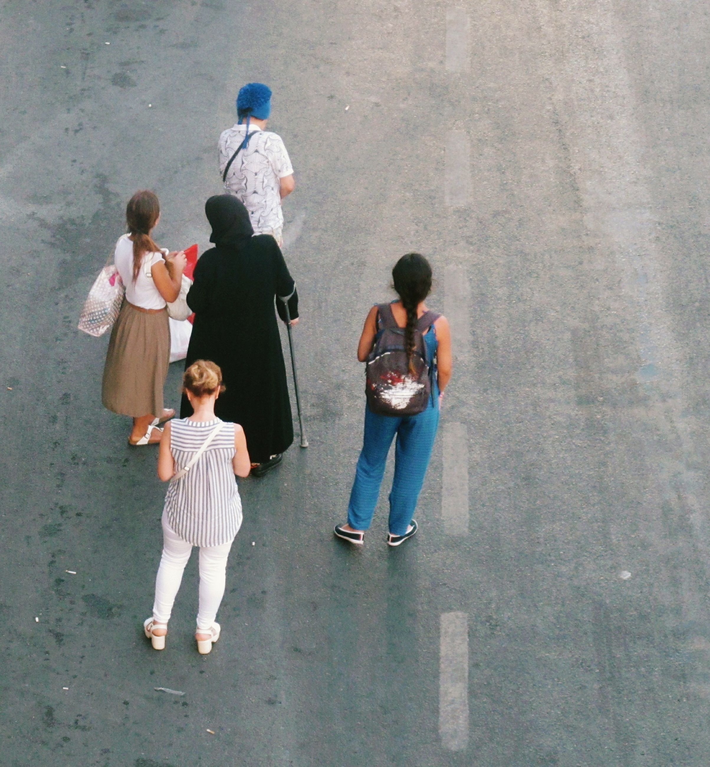 HIGH ANGLE VIEW OF PEOPLE STANDING ON THE FLOOR