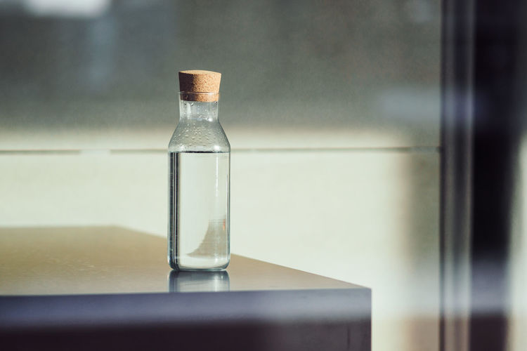 Close-Up Of Bottle On Table