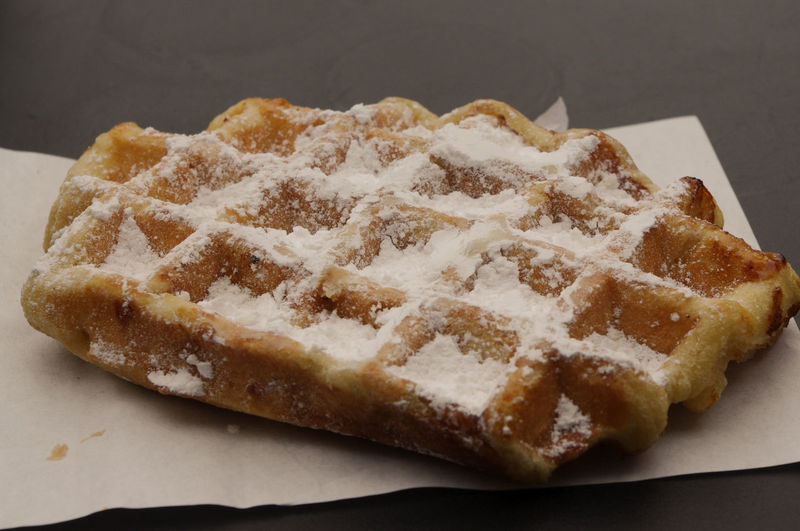 Belgian waffle with power sugar topping Brussels Europe Capital Cities  Waffles Belgian Waffles No People Food Food And Drink Ready-to-eat Freshness Still Life Sweet Food Indulgence Indoors  Close-up Dessert Sweet Baked Temptation Unhealthy Eating White Color Plate High Angle View Brown Table Snack