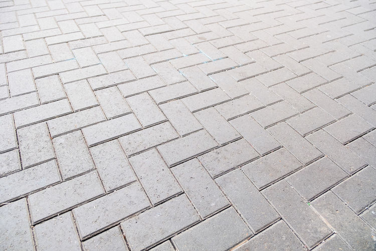 Concrete paver block floor pattern for background Pattern Backgrounds Full Frame Textured  No People High Angle View Day Repetition Design Footpath Shape Close-up Flooring Gray Street Paving Stone Outdoors Rough Focus On Foreground Tile Concrete Textured Effect
