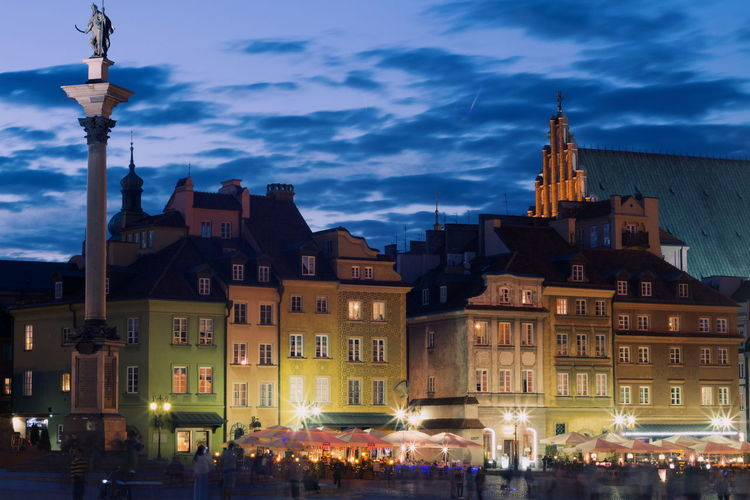 Warsaw old town by street against sky at night