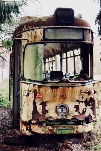 Abandoned vintage car on field