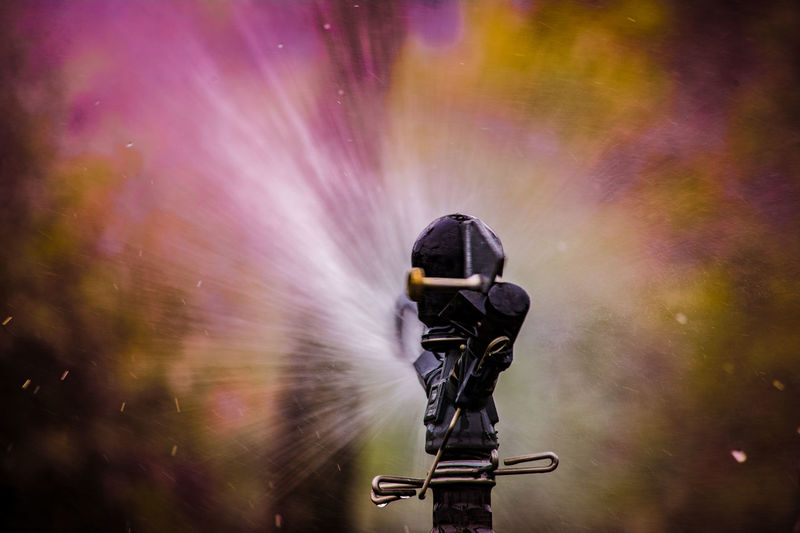 Close-up of sprinkler spraying water