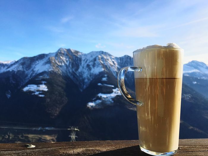 Close-Up Of Coffee With Mountain In Background