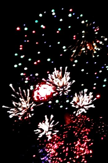 Celebration Firework - Man Made Object Exploding Night Firework Display No People Arts Culture And Entertainment Multi Colored Event Celebration Event Christmas Low Angle View Black Background Sky Illuminated Outdoors Lit Heck