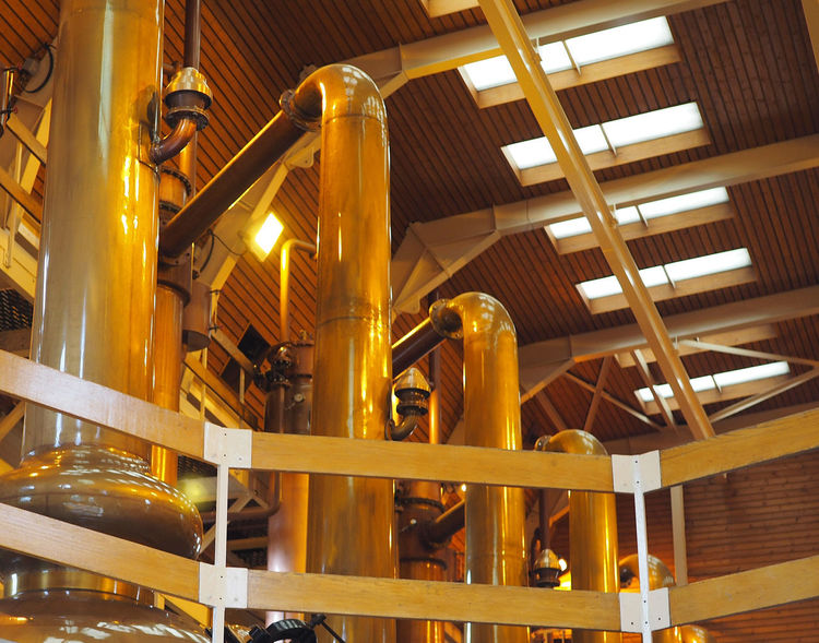 The Glenmorangie distillery who some think produce the finest single malt whisky in Scotland - near Invergordon, Highlands of Scotland Industry Day Factory Technology Indoors  Glenmorangie No People Efficiency Invergordon Single Malt Whisky Low Angle View Built Structure Fuel And Power Generation Pipe - Tube Orange Glow Oil Pump Manufacturing Equipment Glenmorangie Distillery Scottish Highlands, Scotland, Highlands, Oban, Isles, Colour, Sea, Rocky, Rugged, Slate, Crashing Waves, Surf, Sky, Cloud, Remote, Great Britain, Natural Beauty, Landscape, Seascape, Waves Distillery Equipment