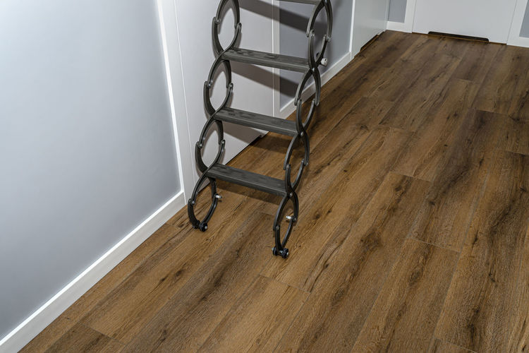 High angle view of chair on hardwood floor at home