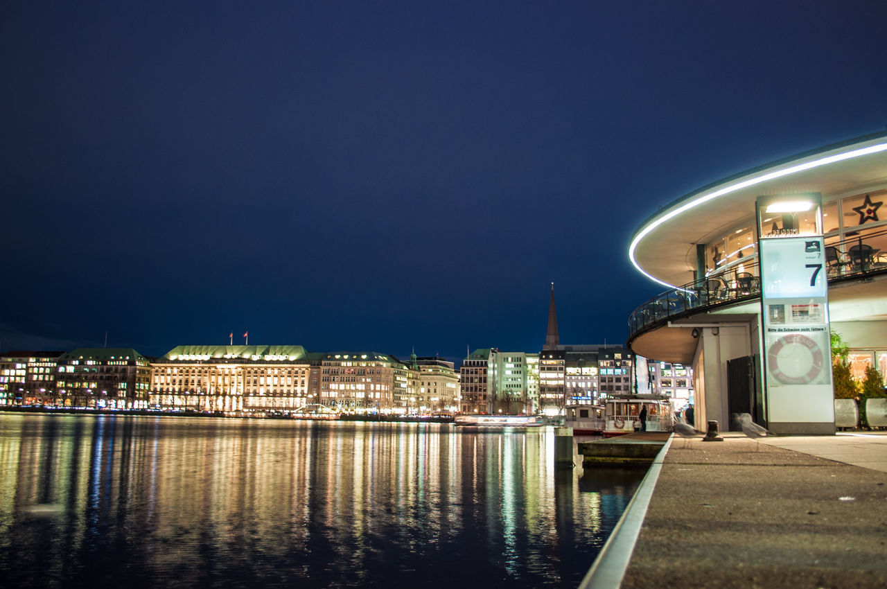 building exterior, night, architecture, illuminated, built structure, no people, city, outdoors, water, sky, town, blue, sea, clear sky, cityscape