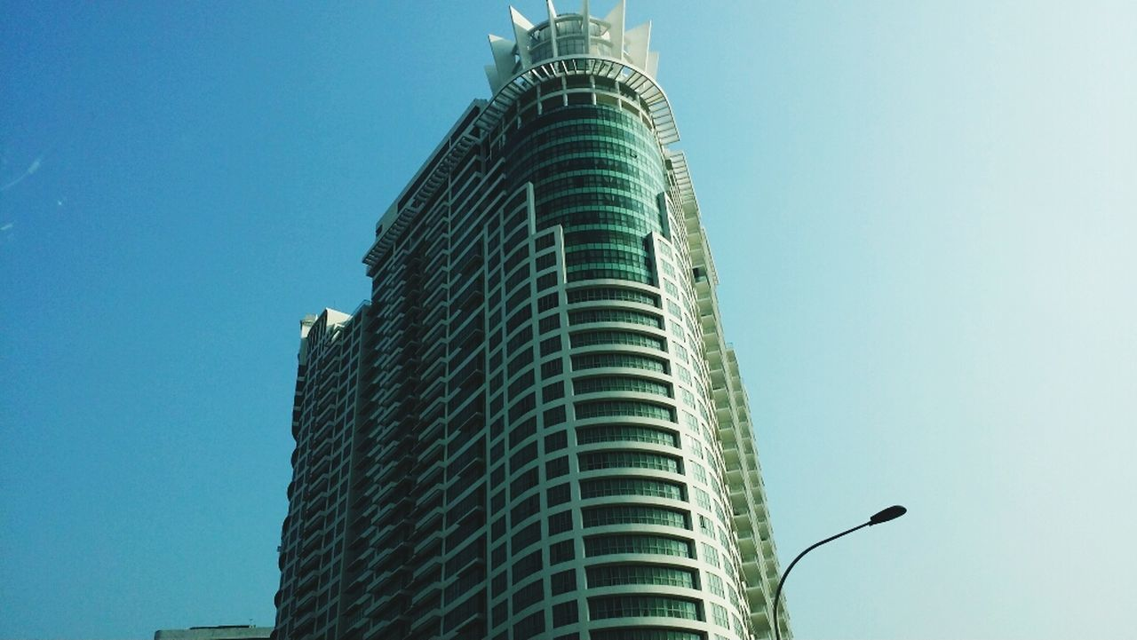skyscraper, architecture, modern, tower, built structure, low angle view, building exterior, city, blue, clear sky, outdoors, day, no people, cityscape, sky