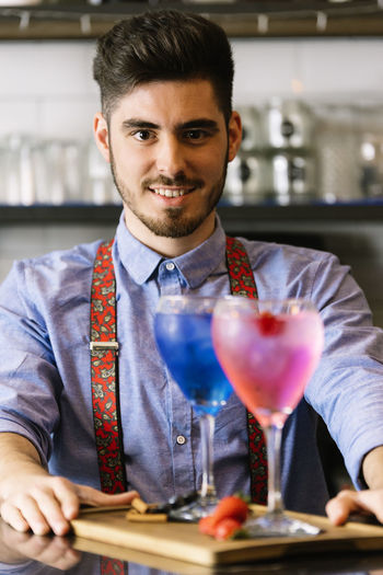 Bartender With Drinks In Restaurant