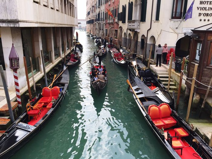 Connected By Travel Nautical Vessel Transportation Canal Mode Of Transport Water Building Exterior Gondola - Traditional Boat Built Structure Moored Day Large Group Of People Travel Destinations Real People Outdoors Men People