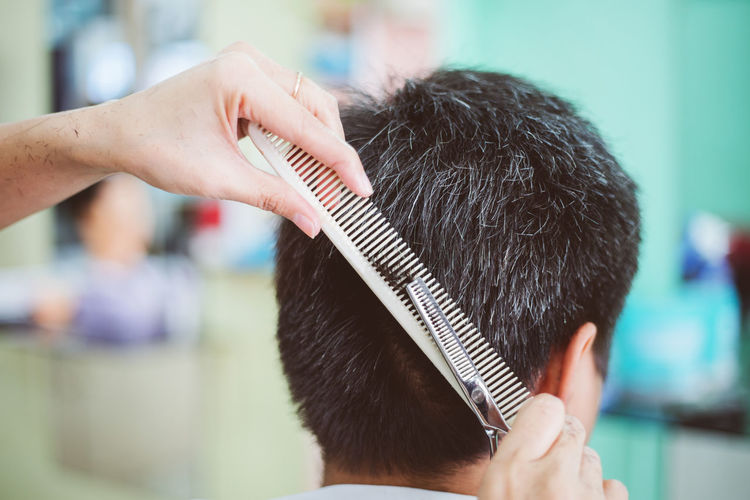 Barber Close-up Combing Cutting Cutting Hair Day Focus On Foreground Hair Care Hairdresser Hairstyle Human Body Part Human Hair Human Hand Indoors  Mammal Men Occupation Real People Rear View Two People