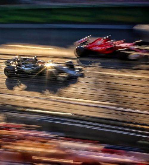 Blurred Motion Speed Motion Sports Photography Formula 1 Motorsport High Speed Photography Ferrari Scuderia Ferrari Haas F1 Baku City Circuit Golden Hour Visit Azerbaijan
