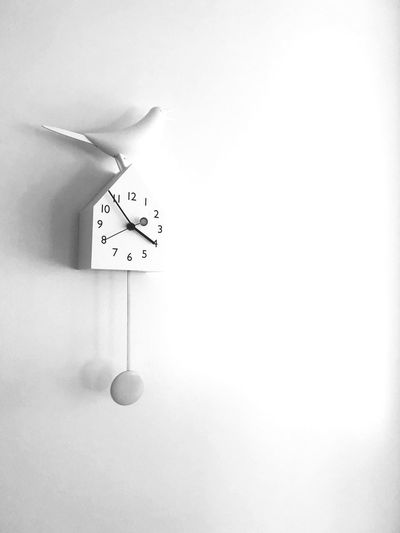 Wall clock hanging on wall