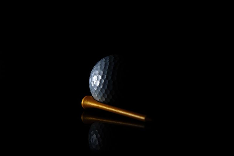 Sport Ball Tee Golftee Golfball Golf Black Background Studio Shot No People Gold Colored Close-up Business