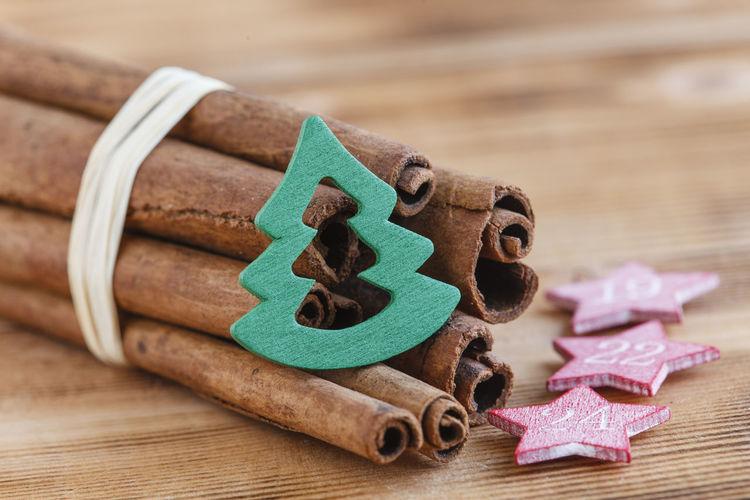 Bundle of cinnamon sticks with christmas decoration on table