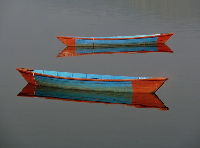 """Pokhara boats"" revisiting some Nepal images, amazingly photogenic country, hopefully recovering from the earthquakes🙏 Pokara Lake View Two Boats Calmness Tranquility Simplicity No People Nepal Blue On Gray Abstract Travel Photography Art In Everything Art Is Everywhere EyeEm Selects"