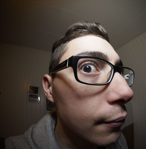 Fish Eye View Of Young Man Wearing Eyeglasses