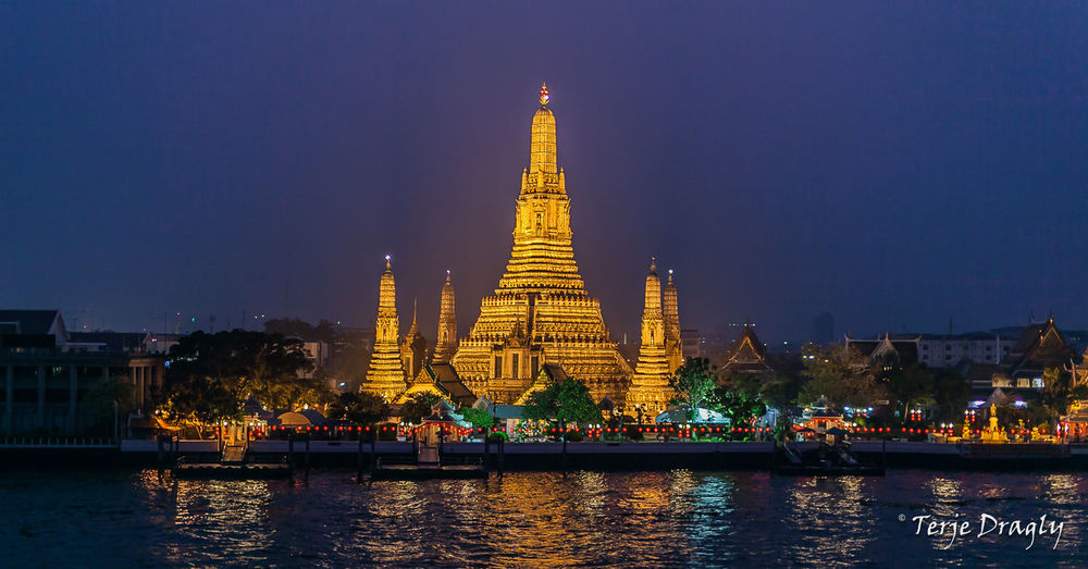 Wat Arun just after sunset. Watarun Bangkok Thailand Chao Phaya River Streetphotography Night Lights Canonphotography Canon 5D Mark II Sigma 50mm F1.4 DG Nightphotography Street Photography Travel Architecture History Gold Colored