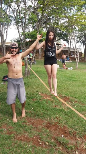 Lifestyles Happiness Smiling Tree Green Color Young Adult Playing Enjoyment Slackline Friendship That's Me