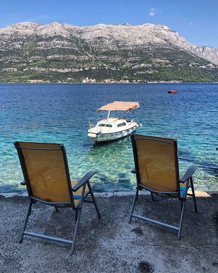 Water Chair Seat Nature Absence Sea Lounge Chair Luxury Beach Sunlight Outdoors Beauty In Nature Tranquil Scene Tranquility Day Empty No People Scenics - Nature Transportation